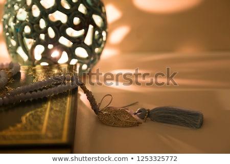 Muçulmano rosário isolado branco livro luz Foto stock © aza