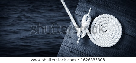 spiral white sea nautical rope on boat mooring stock photo © lunamarina