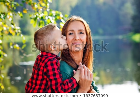 son embraces behind mother  in park in spring Stock photo © Paha_L
