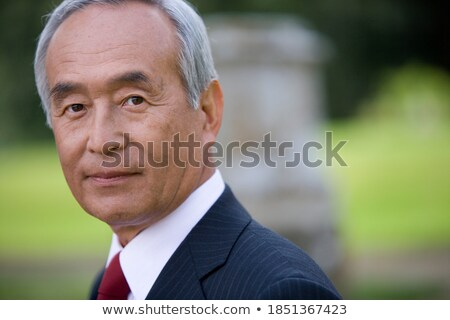 close up of senior in business suit and red tie stock photo © ozgur