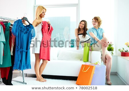 woman trying new clothing sitting on sofa stock photo © elnur