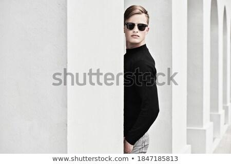 портрет красивый молодым человеком позируют черный Сток-фото © konradbak