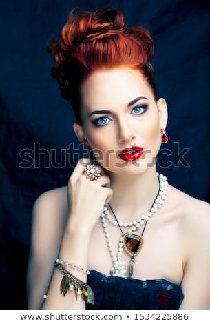 beauty stylish redhead woman with hairstyle wearing jewelry stock photo © iordani