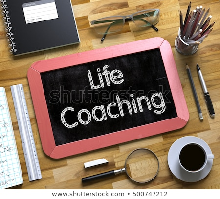 business coaching   text on small chalkboard 3d illustration stock photo © tashatuvango