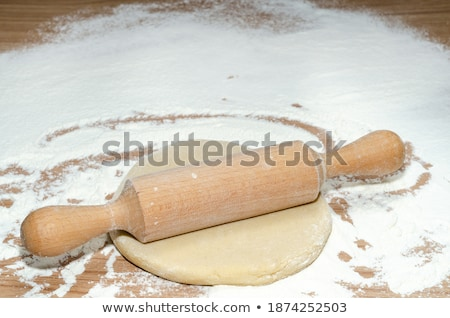 Flattened dough sprinkled with flour on a wooden table Stock photo © wavebreak_media