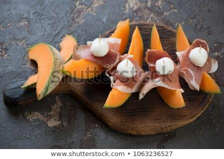 Lövés szeletek dinnye kövek darabok citromsárga Stock fotó © deandrobot