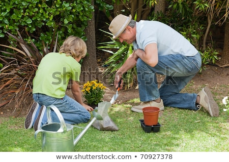 Grandfather and grandson digging Stock photo © IS2