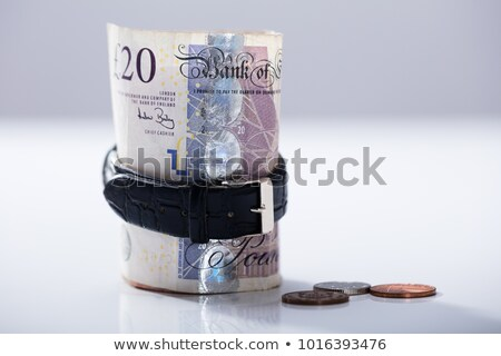 Rolled Up Twenty Pounds Currency Note Inside The Wrist Watch Stock photo © AndreyPopov