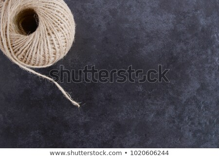 Ball of twine from above, unwinding on grey background  Stock photo © sarahdoow
