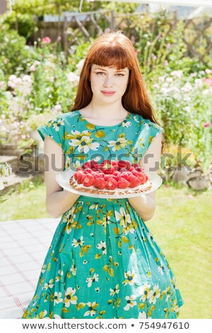 woman stands strawberry tart in garden. Stock photo © IS2