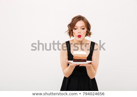 Young girl blowing candles out on cake Stock photo © IS2