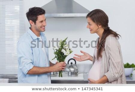 man · bloemen · zwangere · vrouw · home · vakantie · zwangerschap - stockfoto © dolgachov