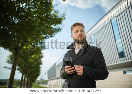 attractive stylish man posing seductively while standing Stock photo © feedough