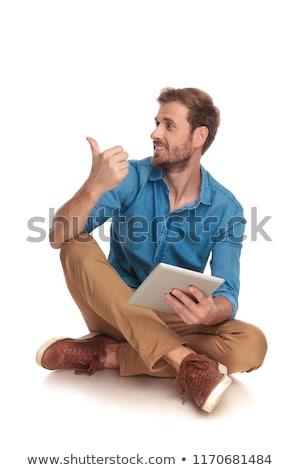 Stock fotó: ülő · fiatal · lezser · férfi · tabletta · pontok