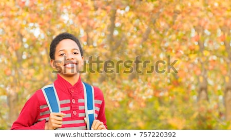 студент за пределами школы Постоянный улыбаясь мальчика Сток-фото © Lopolo