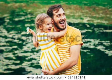 happy father and daughter playing at autumn park stock photo © dolgachov