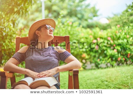 jovem · varanda · sorridente · sessão · olhando - foto stock © konradbak