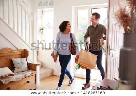 Shopping Woman and Man Carrying Bags Returning Home Stock photo © robuart