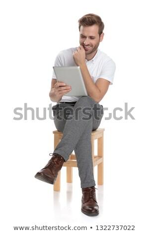 улыбаясь сидящий человека таблетка белый бизнеса Сток-фото © feedough