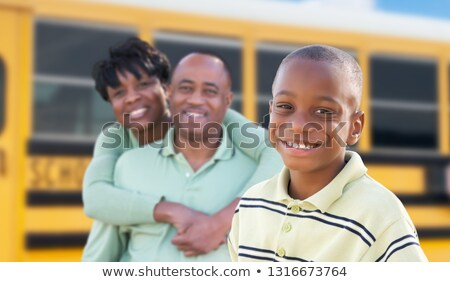 Proud African American Parents and Young Boy Near School Bus Stock photo © feverpitch