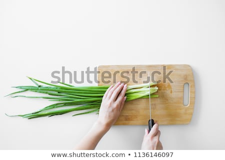 cook cuts onion on a wooden board stock photo © oleksandro