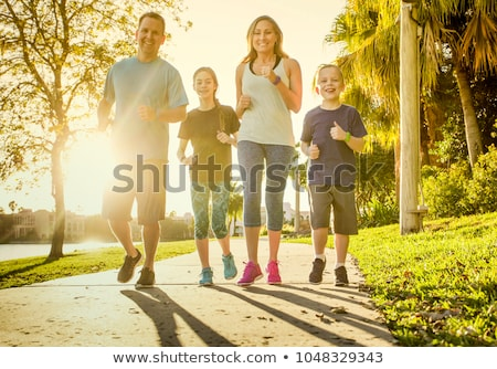 Family exercising in a park Stock photo © colematt