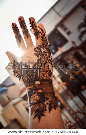 Woman with mahendi. Hand decorated with henna Tattoo. mehendi hand Foto d'archivio © galitskaya