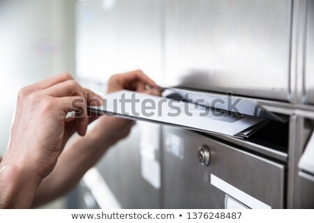 Human's Hand Inserting Letters In Mailbox Stock photo © AndreyPopov