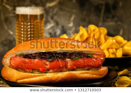 Hot dogs with glass of beer with crisps,french fries on wooden b Stock photo © dla4