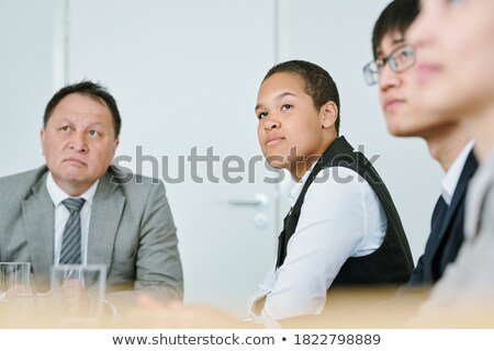 Young successful intercultural colleagues listening to coach Stock photo © pressmaster