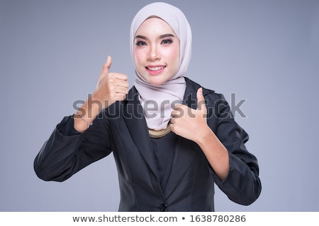 Close-up of businesswoman showing and presenting for financial g Stock photo © Freedomz