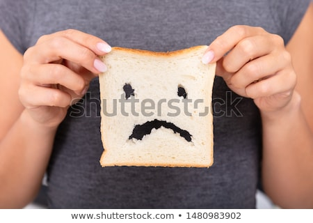 Woman Holding Slice Of Bread With Sad Face Stock photo © AndreyPopov