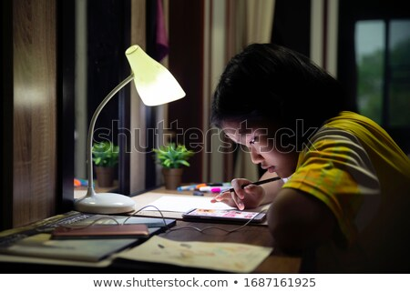 student girl with smartphone doing homework stock photo © dolgachov