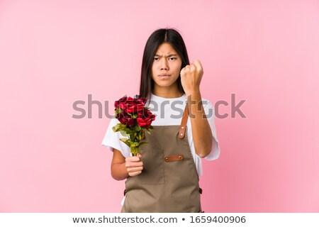 Kertész nő mutat rózsa kamera áll Stock fotó © Kzenon