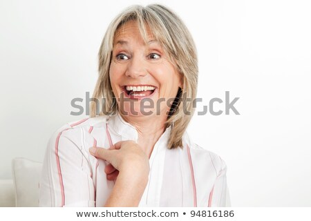 senior woman laughing out loud in living room Stock photo © Lopolo
