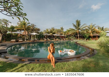 Woman relaxing in her tropical vacation sitting in the jungle Stock photo © Kzenon