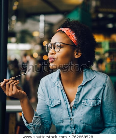 Genç kadın lokanta güzel yeme Stok fotoğraf © boggy