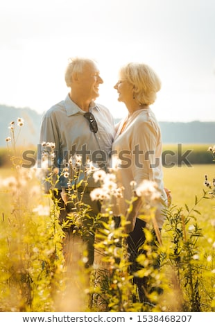 Senior woman and man hugging still being in love Stock photo © Kzenon