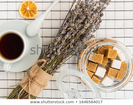 Glass bowl of natural white refined sugar with cubes on light table background with STOp letters. Un Stock photo © DenisMArt