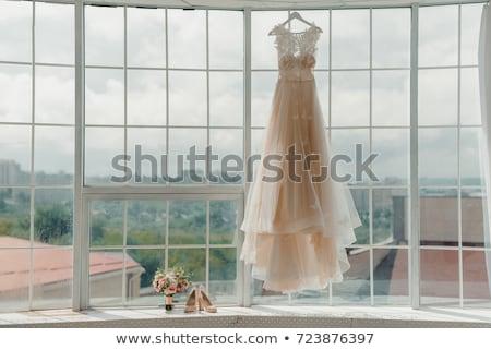 Hands of bridesmaids on bridal dress Stock photo © tilo