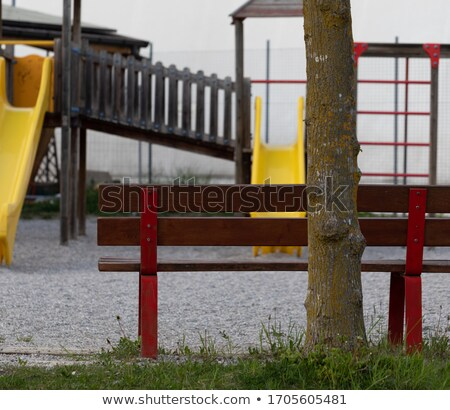 Bench overlooking a deserted kids playground Stock photo © Giulio_Fornasar