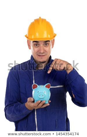 Construction worker with yellow helmet and moneybox  Stock photo © Gelpi