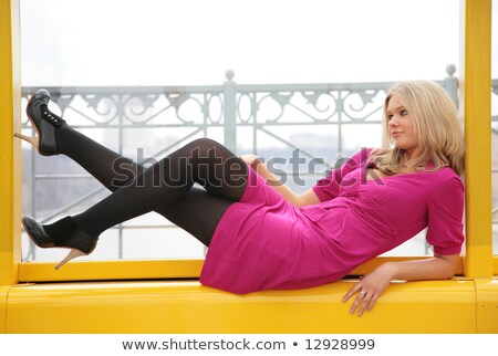 young blonde lies in window on footbridge Stock photo © Paha_L