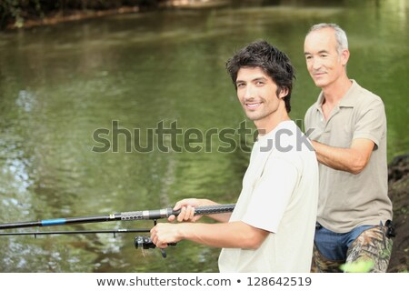 an old man and a young man angling beside a river Stock photo © photography33