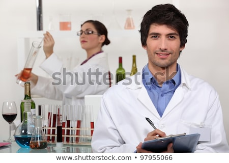 Two scientists in wine testing facility Stock photo © photography33