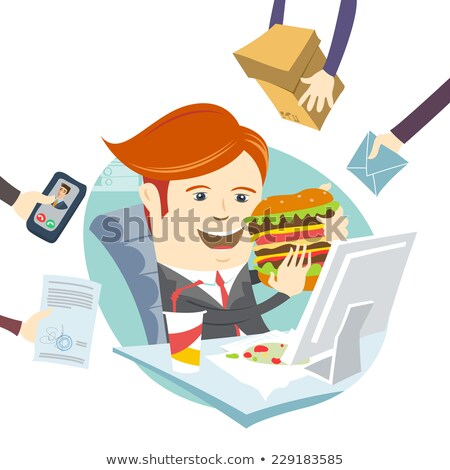 Businessman eating a burger at his desk Stock photo © photography33