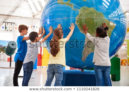 Dark-haired boy with globe Stock photo © photography33