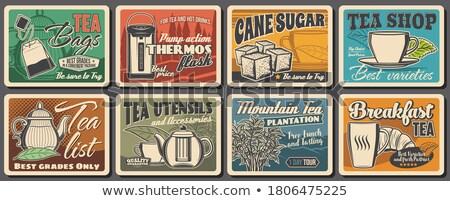 Hot cup of tea and sugar cubes and tea box Stock photo © ozaiachin