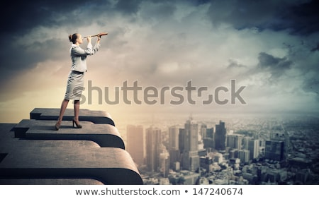 young business woman with binoculars stock photo © clearviewstock