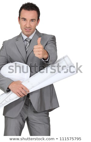 Man dressed in suite holding hard hat and blue-prints Stock photo © photography33